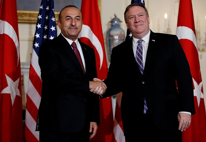 Foreign Minister Mevlu00fct u00c7avuu015fou011flu shakes hands with U.S. Secretary of State Mike Pompeo at the State Department in Washington, U.S., June 4, 2018. (Reuters Photo)