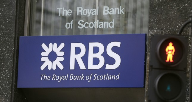 The Royal Bank of Scotland reported a pretax operating loss of 695 million pounds in the second quarter. (AP Photo)