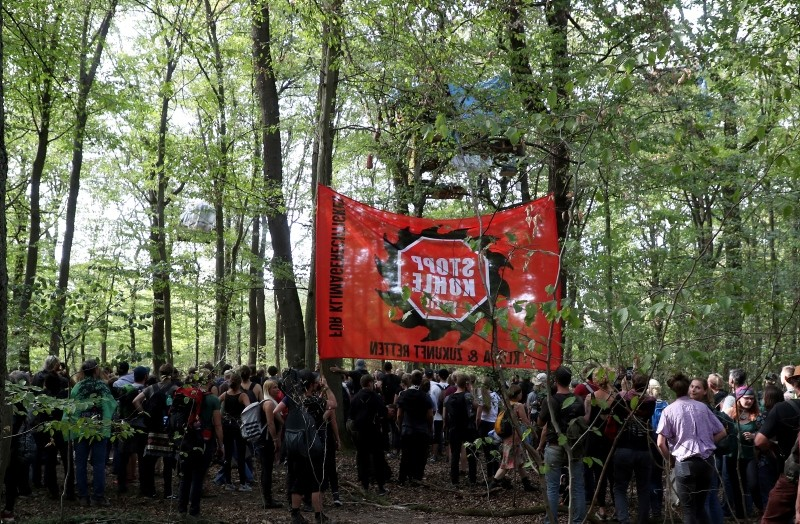 Demonstrators in the forest during a searching and clearing operation at an environmental activists camp in the forest Hambacher Forst in Morschenich, Germany, 16 September 2018. (EPA Photo)
