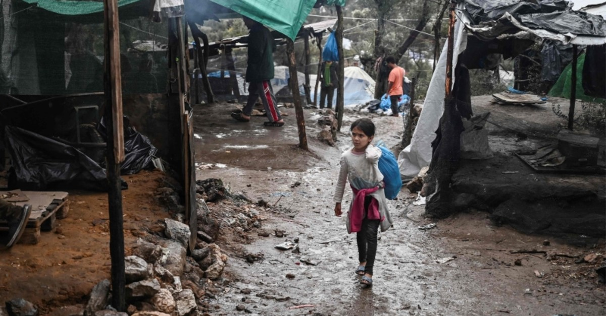A young girl walks outside the overcrowded refugee camp of Moria, near the capital Mytilene, in the island of Lesbos on November 26, 2019. (AFP Photo)