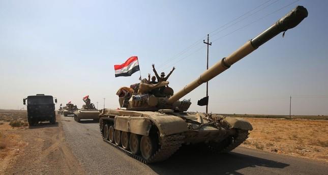 Iraqi forces drive toward KRG peshmerga positions on Oct. 15, on the southern outskirts of Kirkuk.