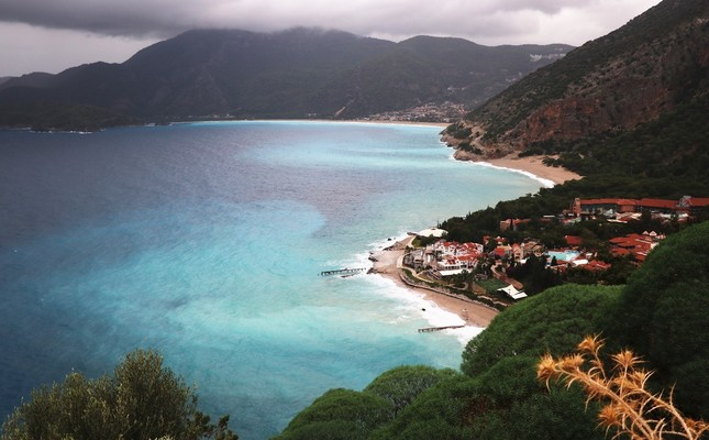 Under dark clouds, Fethiye's Ölüdeniz is a winter paradise