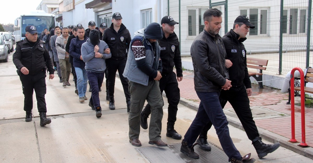 Police escort 16 suspects captured in an operation into FETu00d6u2019s military infiltration to the courthouse in Adana, Feb. 28, 2019.
