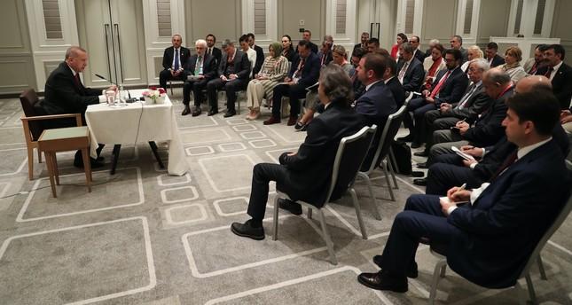 President Recep Tayyip Erdoğan addresses accompanying Turkish journalists in Osaka, June 29, 2019.