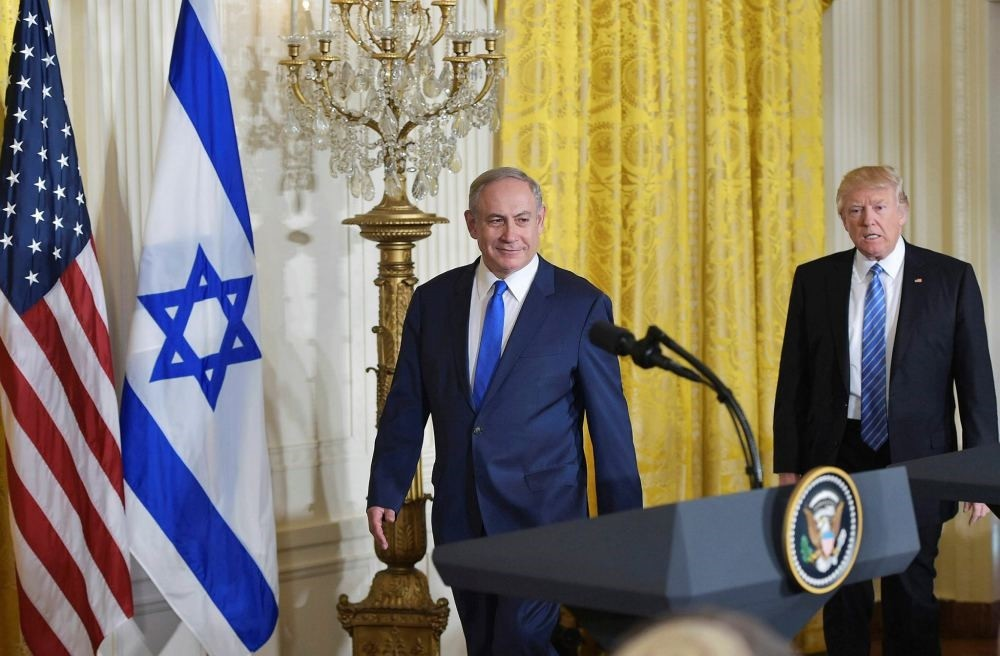 U.S. President Donald Trump and Israel's Prime Minister Benjamin Netanyahu arrive for a joint press conference in the East Room of the White House on February 15.