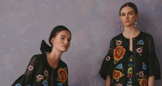 This photo provided by Griffin Marketing and Public Relations and Carolina Herrera shows models posing for the Carolina Herrera Resort Collection 2020. AP Photo