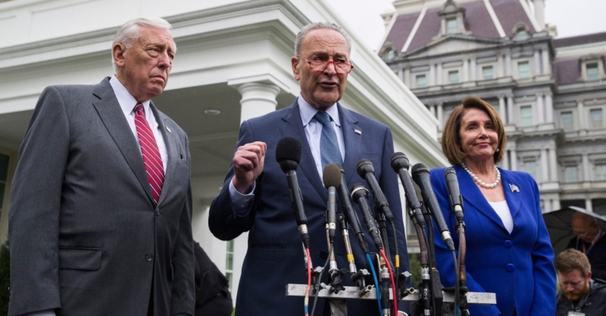 House Majority Leader Steny Hoyer of Md., left, Senate Minority Leader Chuck Schumer of N.Y., and House Speaker Nancy Pelosi of Calif., speak with reporters after a meeting with President Donald Trump at the White House, Oct. 16, 2019. (AP Photo)