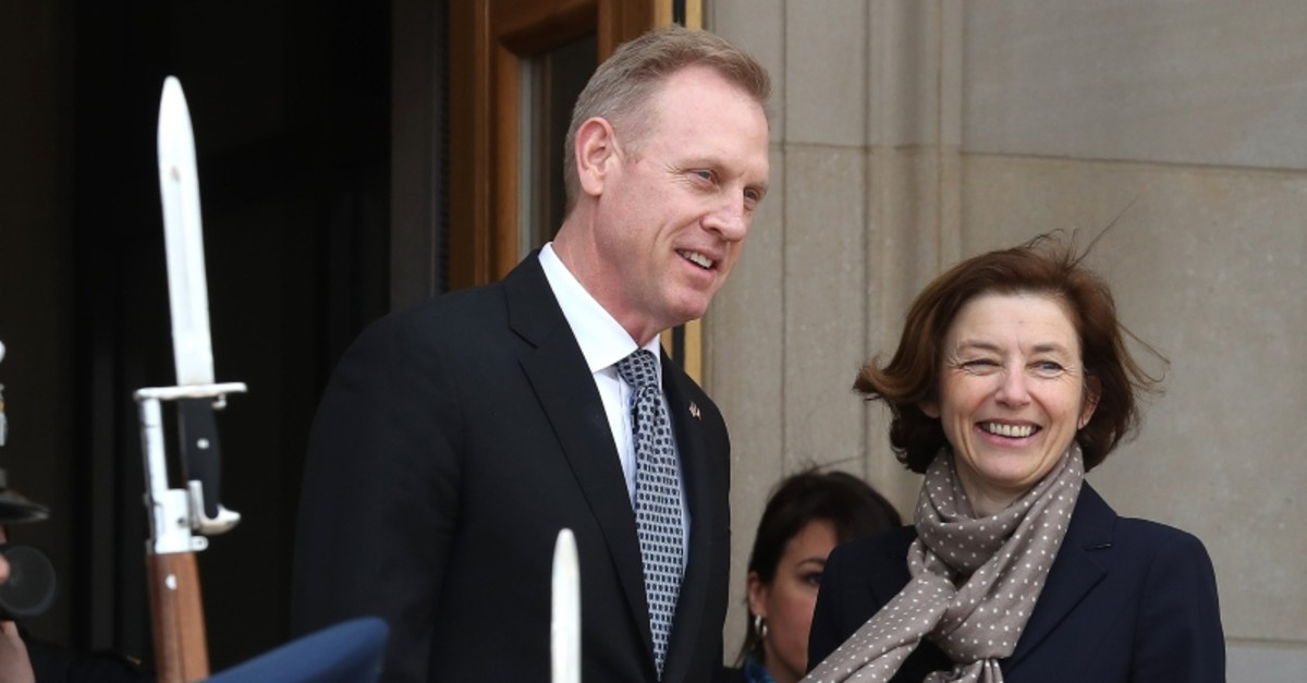 Acting Defense Secretary Patrick Shanahan welcomes French Armed Forces Minister Florence Parly during a honor cordon at the Pentagon on March 18, 2019 in Arlington, Virginia. (AFP Photo)