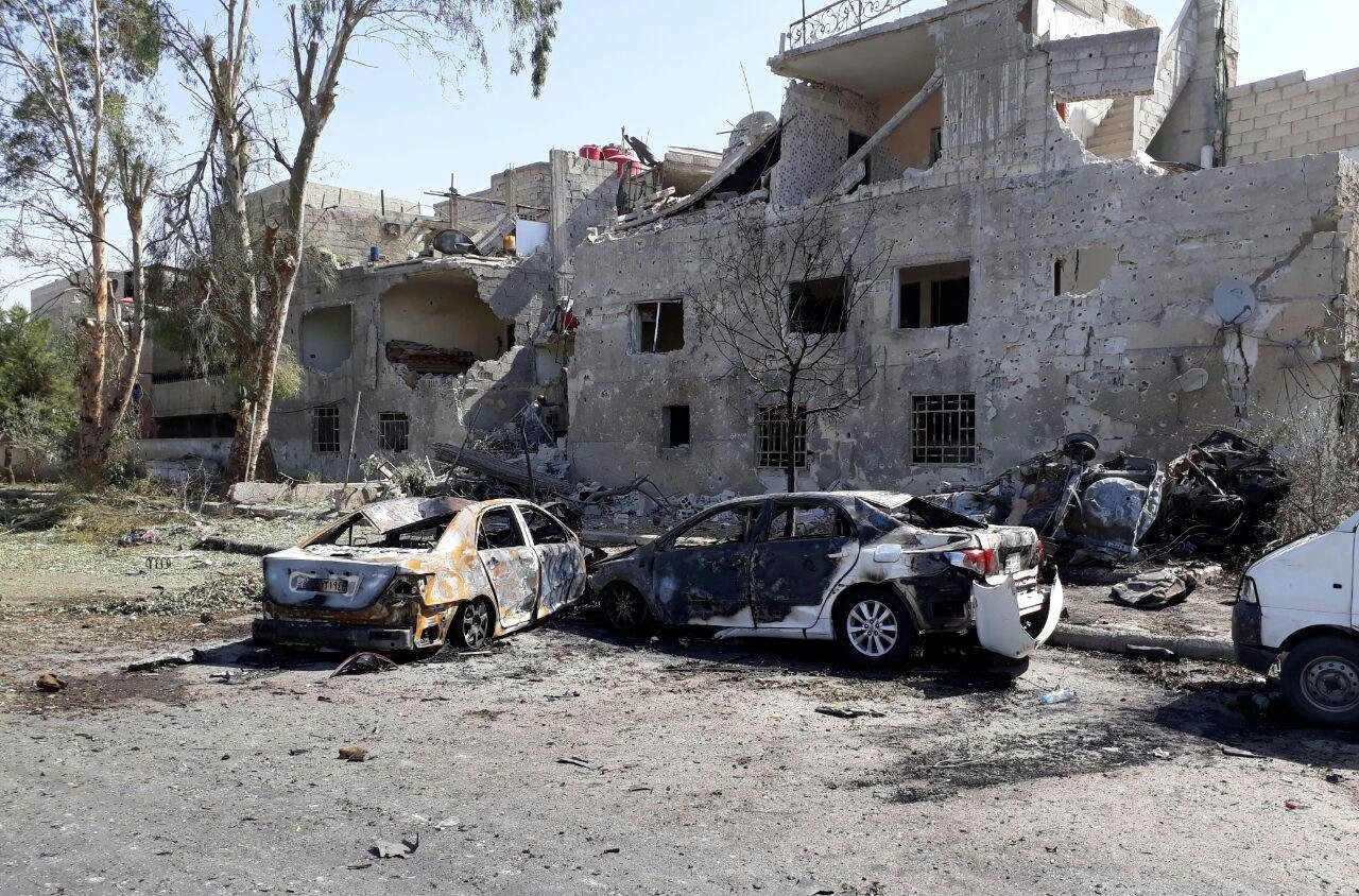 Damaged cars are seen at one of the blast sites in Damascus in this handout picture posted on SANA on July 2, 2017, Syria. (REUTERS Photo)
