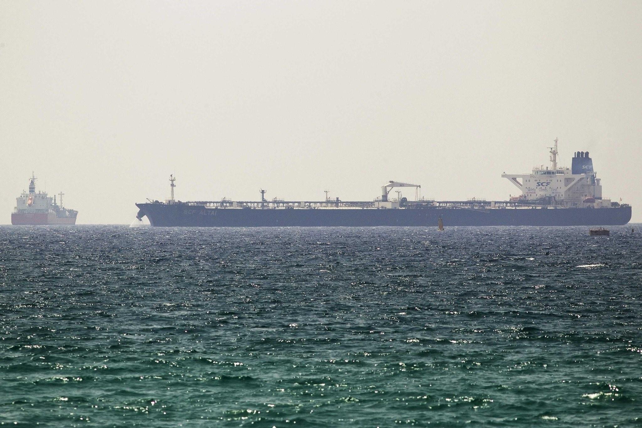 The SCF Altai tanker (R) docks near Israel's Ashkelon port June 20, 2014. (REUTERS Photo)