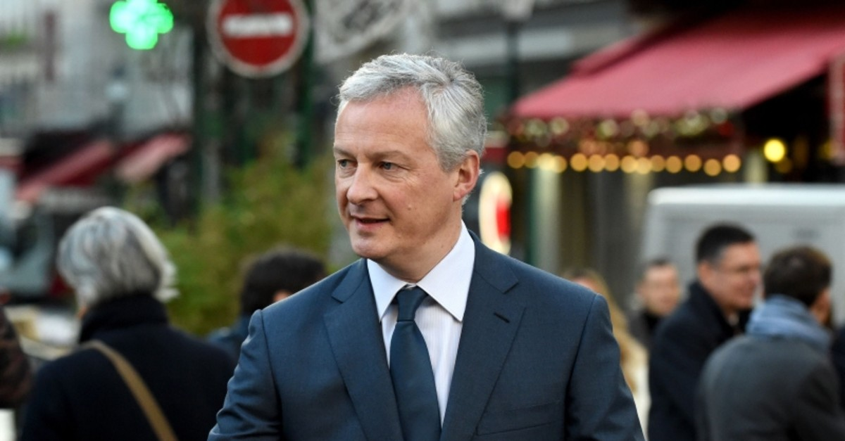 French Finance and Economy Minister Bruno Le Maire visits a shopping area Rue Montorgueil in Paris on January 3, 2020 to talk about the economic impacts of the strikes. (AFP Photo)