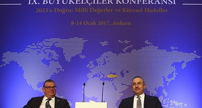 Foreign Minister Mevlüt Çavuşoğlu (Right) with his Finnish counterpart Timo Soini (Left) as the annual ambassadors' conference in Ankara (AA Photo)