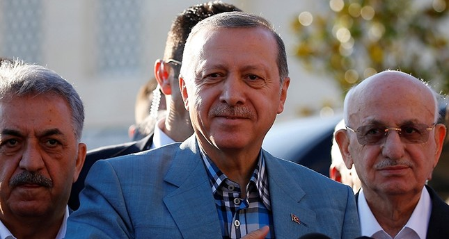 President Recep Tayyip Erdoğan greets the press as he leaves a mosque after the Eid al-Fitr prayers in Istanbul, Turkey, June 25, 2017. (Reuters Photo)