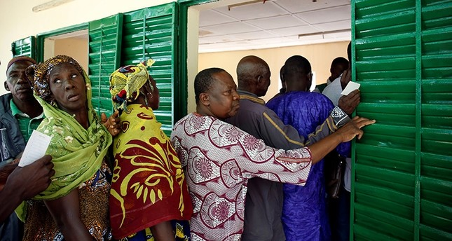 People stand in line as they wait to cast their vote for the presidential election at a polling station in Bamako, Mali July 29, 2018. (Reuters Photo)