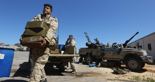 Fighters from a Misrata armed group loyal to Libyan Government of National Accord (GNA) prepare their ammunition before heading to the on April 9, 2019. (AFP Photo)