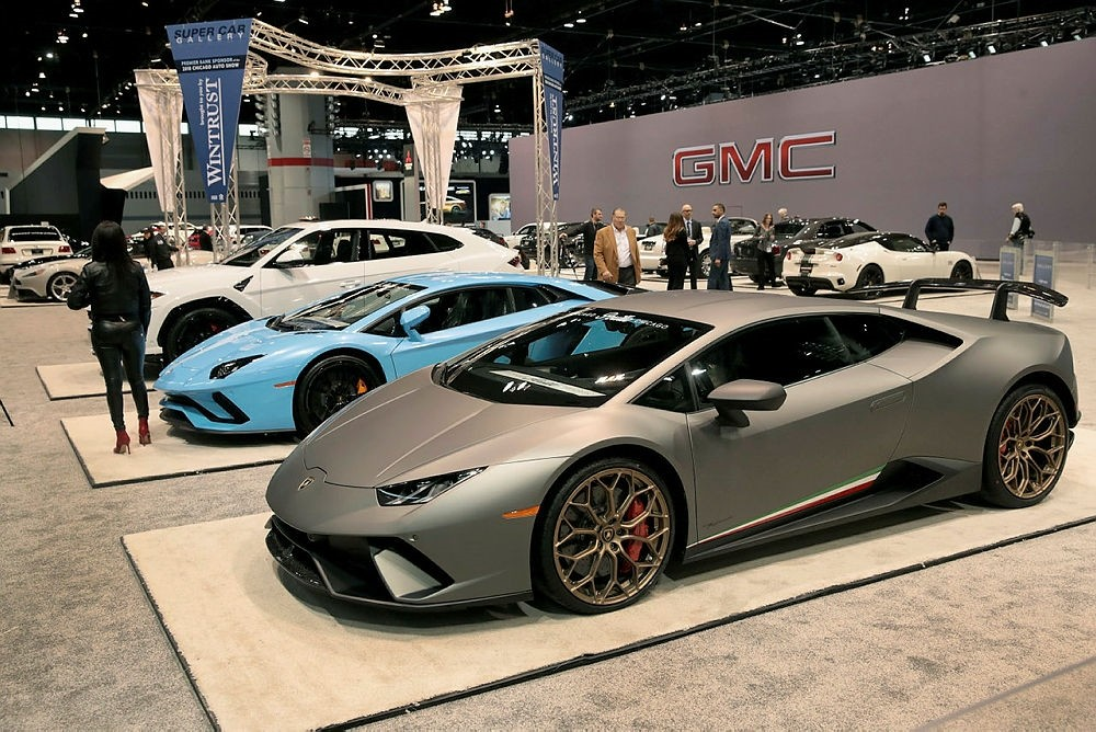 Lamborghinis sit alongside other exotic cars at the Chicago Auto Show.