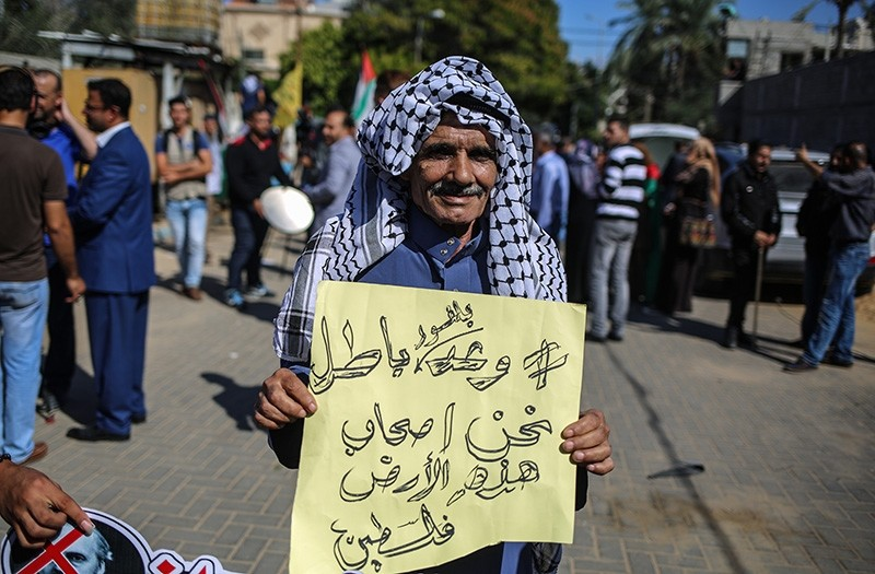 A Palestinian protests in Gaza on the 100th year anniversary of the Balfour Declaration (AA Photo)