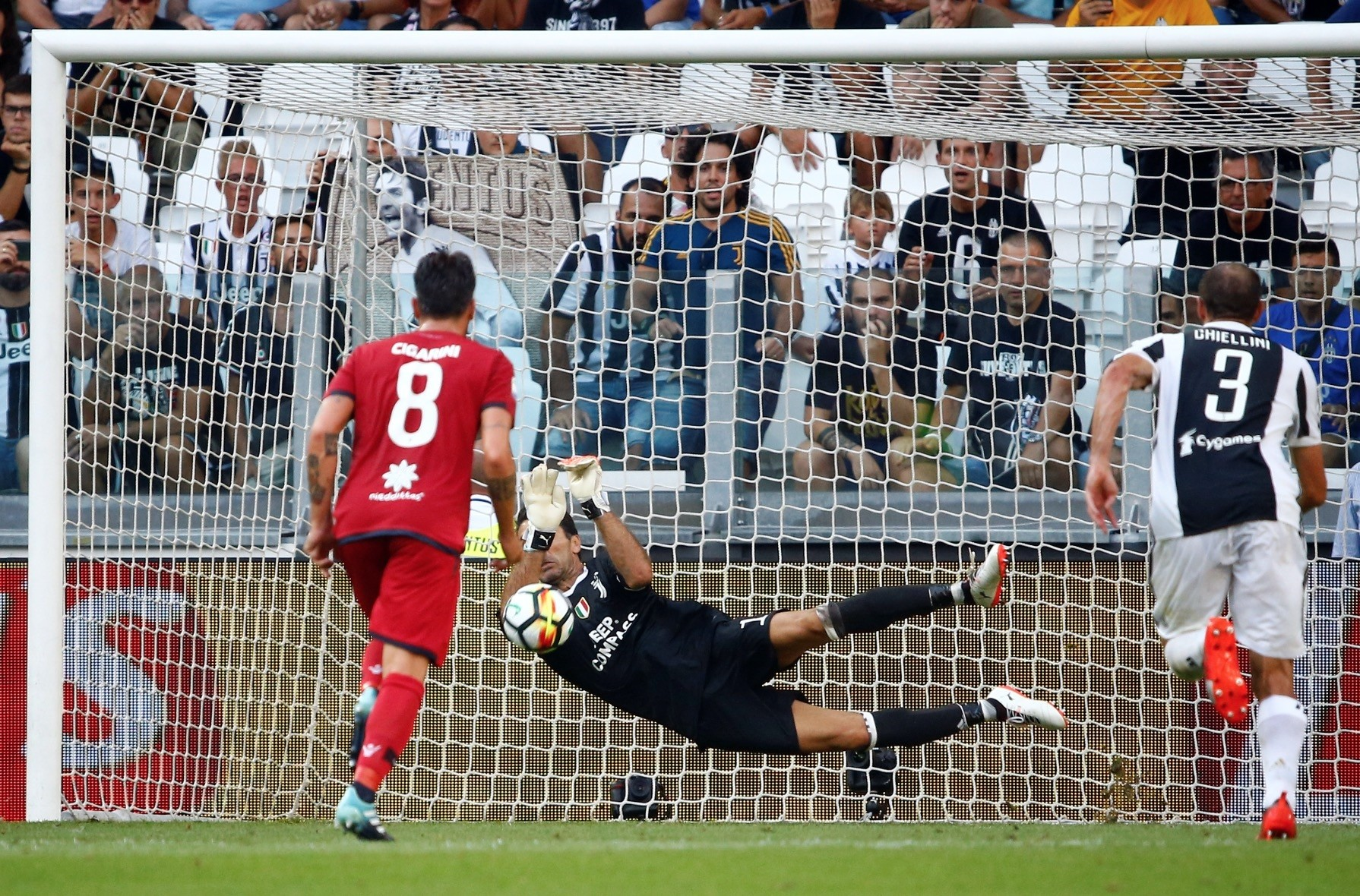 Juventusu2019 Gianluigi Buffon saves a penalty taken by Cagliariu2019s Diego Farias.