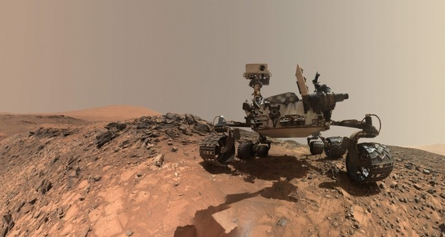 This NASA photo released June 7, 2018 shows a low-angle self-portrait of NASA's Curiosity Mars rover vehicle at the site from which it reached down to drill into a rock target called Buckskin on lower Mount Sharp. (AFP Photo/NASA)