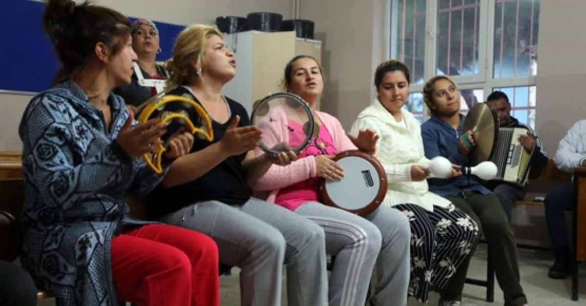 Roma women attend a music class, part of a training program for the community, in Tekirda? in this undated photo. (AA Photo)