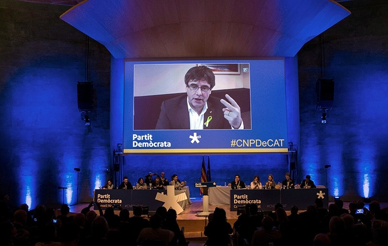 Former Catalan regional president Carles Puigdemont is seen on a screen as he delivers a speech during an act of pro-independence left-wing party Esquerra Repulicana de Catalunya (ERC) held in Barcelona, Catalonia, Spain, 13 Jan. 2018. (EPA Photo)