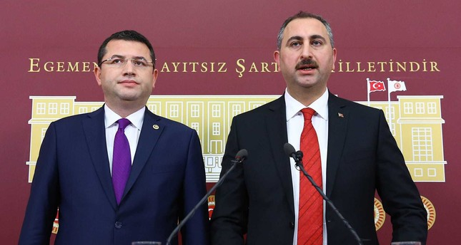 The AK Party General Secretary Abdülhamit Gül and MHP Deputy Mehmet Parsak, speak at the joint press conferance in Parliament regarding the new constitutional package.