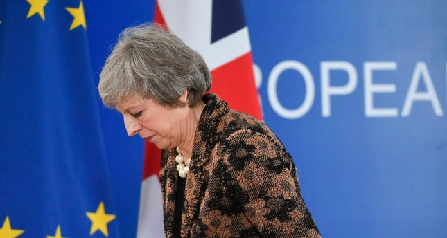 In this file photo taken on December 14, 2018 Britain's Prime Minister Theresa May leaves after speaking during a press conference on December 14, 2018 in Brussels. (AFP Photo)