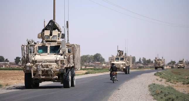 A U.S military convoy is seen on the main road in Raqqa, Syria July 31, 2017 (Reuters File Photo)