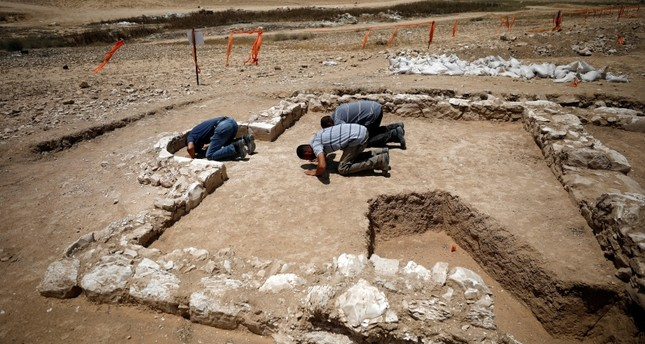 Workers pray inside the remains of a mosque discovered by the Israel Antiquities Authority and which they say is one of the world's oldest mosques, in the outskirts of the Bedouin town of Rahat (Reuters Photo)