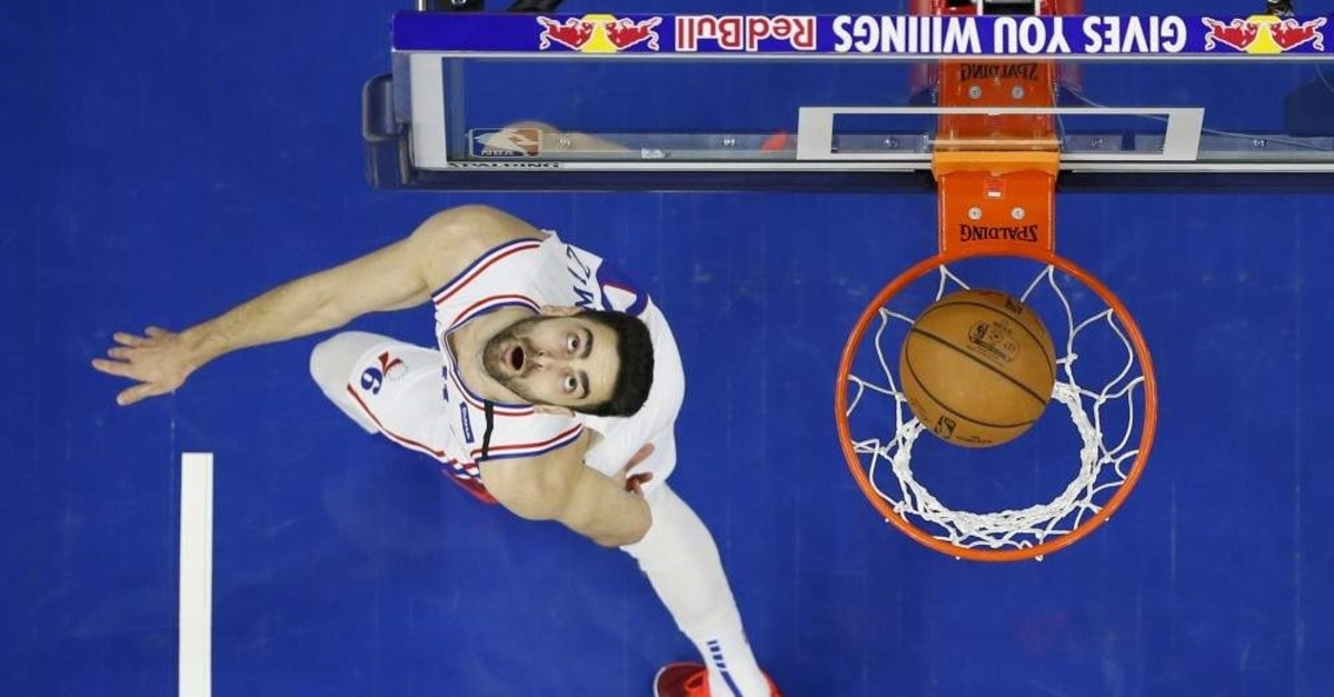 Philadelphia 76ers' Furkan Korkmaz watches his shot during the first half of an NBA basketball game against the Chicago Bulls, Sunday, Feb. 9, 2020, in Philadelphia. (AP Photo)