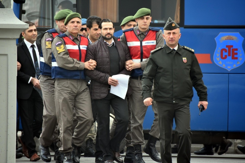Gendarmerie officers escort Ali Saru0131bey to the courtroom. Saru0131bey, a lieutenant who was in the team of assassins sent to kill Erdou011fan, testified at yesterday's hearing in the city of Muu011fla.