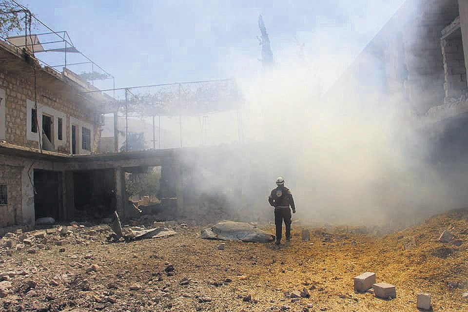 Smoke rises following a series of airstrikes by the Russian military that killed four civilians and wounded five others, Idlib, northern Syria, early Tuesday.