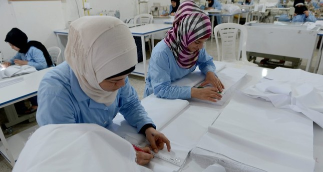 Syrian women working in a textile workshop in the city of Kilis.