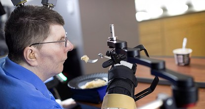 pA paralyzed man in Cleveland fed himself mashed potatoes for the first time in eight years, aided by a computer-brain interface that reads his thoughts and sends signals to move muscles in his...
