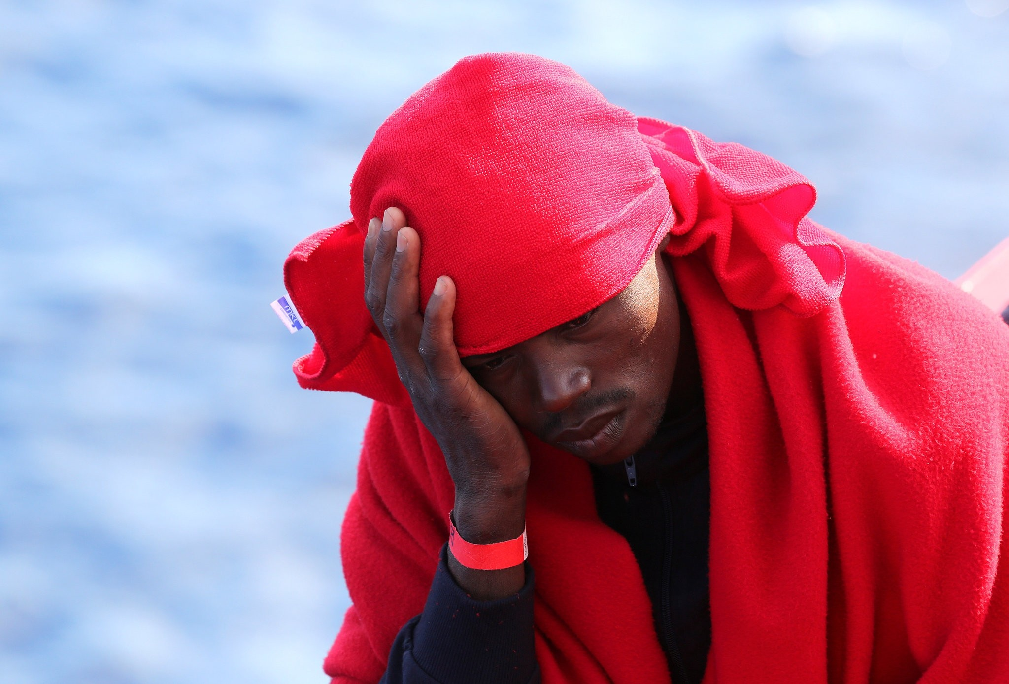 A migrant rests on the Vos Hestia ship after being rescued by the ,Save the Children, NGO crew in the Mediterranean sea off the Libya coast, June 19, 2017. (REUTERS Photo)