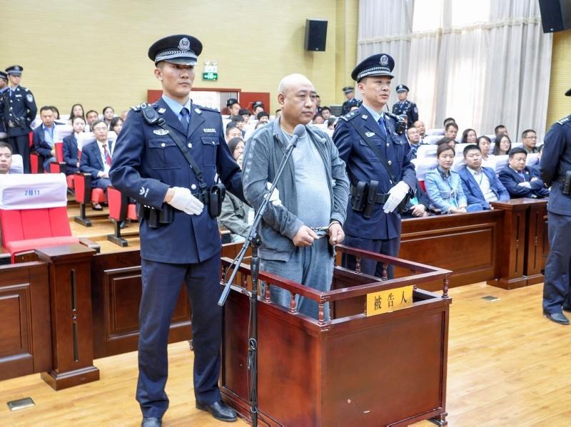 This photo taken on March 30, 2018 shows Gao Chengyong (C) in the Baiyin Intermediate People's Court in Baiyin in China's northwestern Gansu province. (AFP Photo)