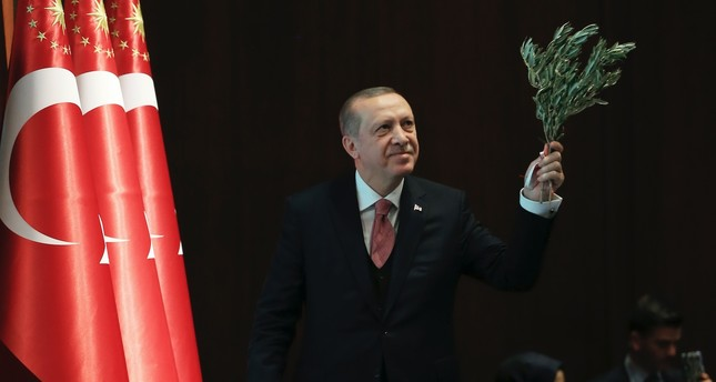 President Erdoğan holding an olive branch arrives before a speech in the capital Ankara, Feb. 20.