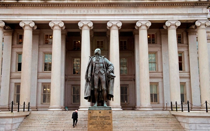 In this file photo taken on January 24, 2017 a man enters the US Treasury Department building on Pennsylvania Avenue  in Washington, DC. (AFP Photo)