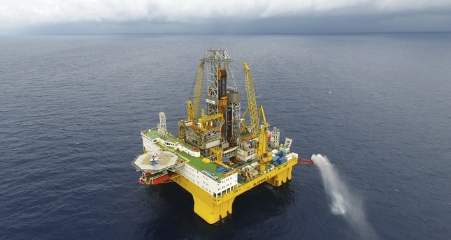 Gas flares out from a drilling platform that extracted natural gas from combustible ice trapped under the seafloor of the South China Sea.