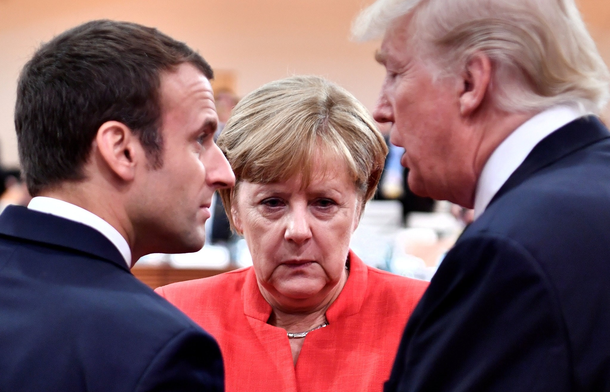 Macron, Merkel and Trump confer at the start of the first working session of the G20 meeting in Hamburg, July 7, 2017. (REUTERS Photo)