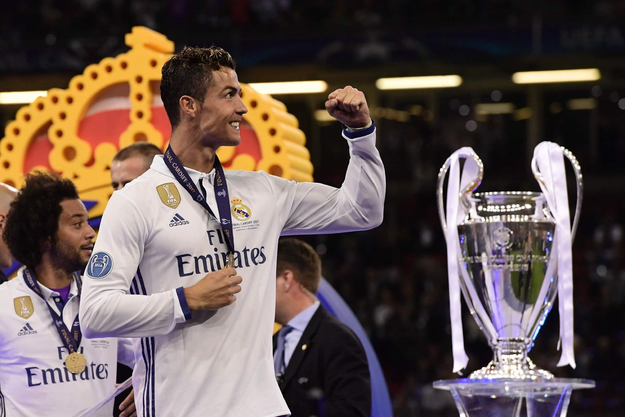 Ronaldo celebrates next to the trophy after Real Madrid won the UEFA Champions League final in Cardiff.