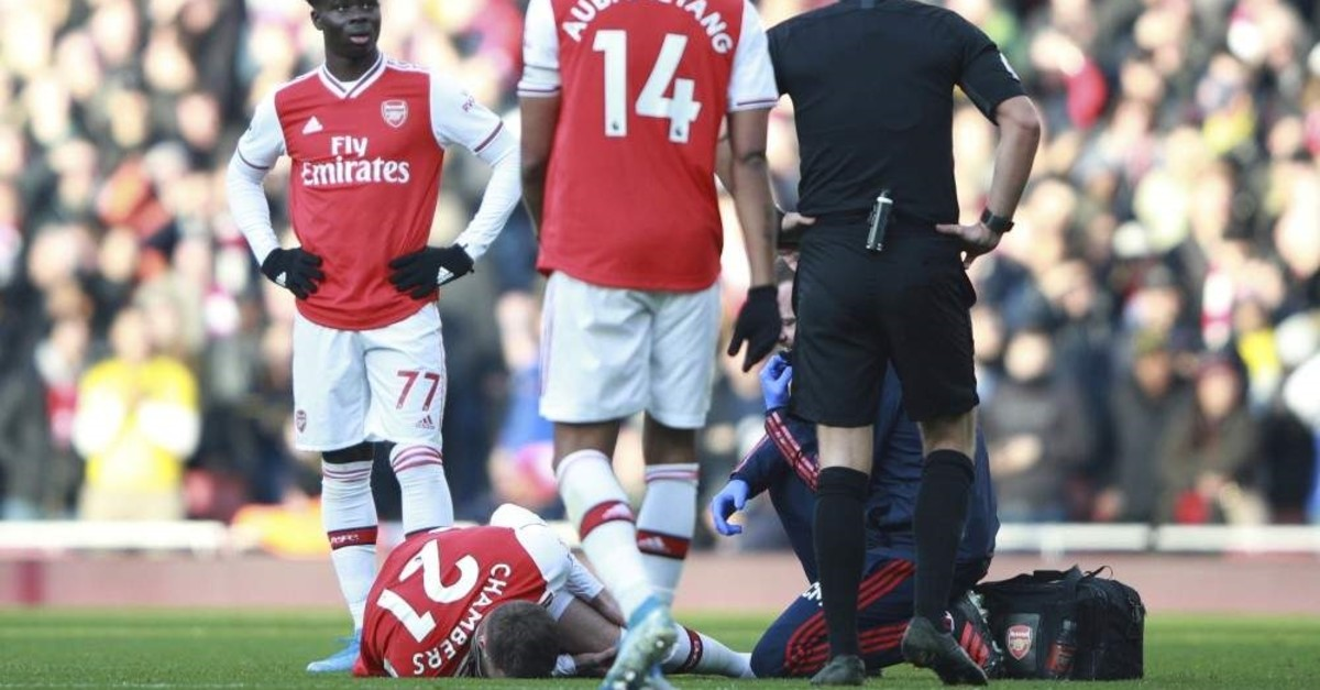 Chambers lies injured on the pitch during the English Premier League match between Arsenal and Chelsea, at the Emirates Stadium in London, Dec. 29, 2019. (AP Photo)