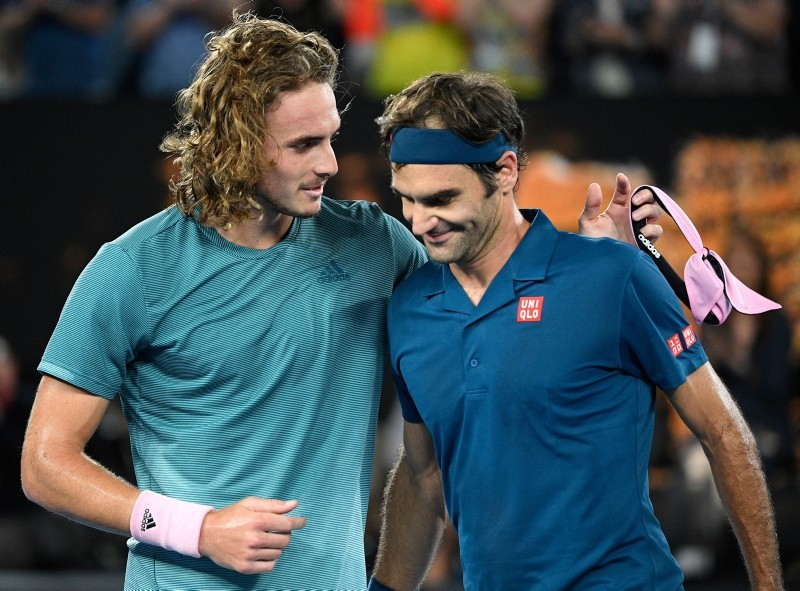 Greece's Stefanos Tsitsipas, left, is congratulated by Switzerland's Roger Federer after winning their fourth round match at the Australian Open tennis championships in Melbourne, Australia, Sunday, Jan. 20, 2019. (AP Photo)