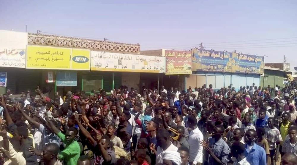 People chant slogans during a demonstration, Kordofan, Dec. 25.