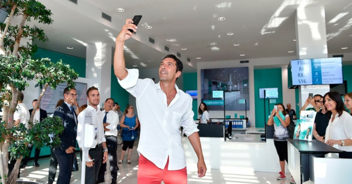 Italian goalkeeper Gianluigi Buffon takes a selfie as he arrives to undergo medical tests at the Juventus Medical Center in Turin, Italy, Thursday, July 4, 2019. (ANSA via AP)