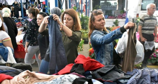 Tourists examine clothes at the local market in Edirne, Oct. 20, 2019. (DHA Photo)