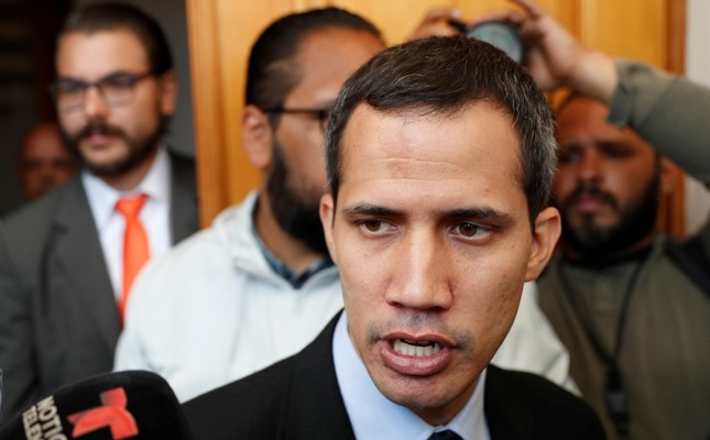 Venezuelan opposition leader and self-proclaimed interim president Juan Guaido talks to the media before a session of the Venezuela's National Assembly in Caracas, Venezuela January 29, 2019. (Reuters Photo)