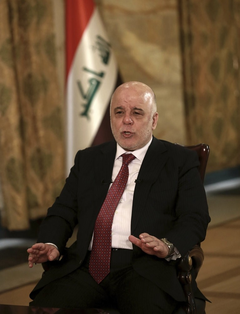 Abadi speaks during an interview in Baghdad, Sept. 16.