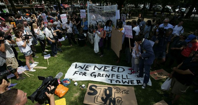 Demonstrators gather in Shepherds Bush in west London to take part in an anti-government protest on June 21.