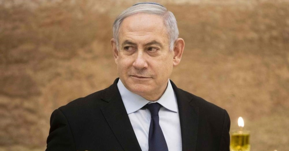 Israeli Prime Minister Benjamin Netanyahu looks on after lighting a Hanukkah candle at the Western Wall in the Old City of Jerusalem, Dec. 22, 2019. (AFP Photo)